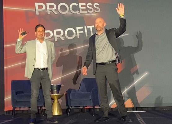 Brian Kaskavalcayan and Shawn Feurer on stage public speaking at Accelerate Live in Fort Lauderdale Florida